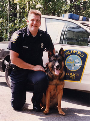 Officer Scott Tanner with K9 Angus, Bedford, NH police department. Grandson of Maxx.
